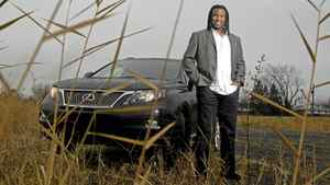 Georges Laraque, ex-NHL hockey player with a hybrid sport utility Lexus in Brossard, Quebec on November 29, 2011. (Christinne Muschi for The Globe and Mail)