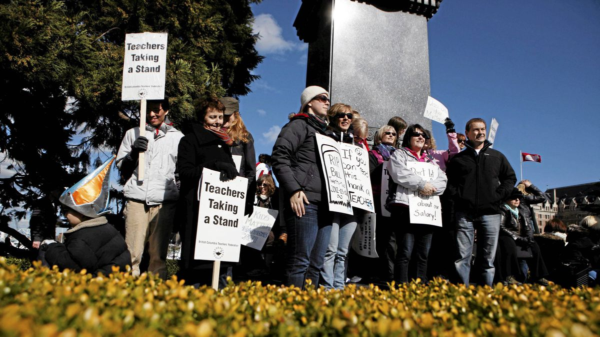 B.C teachers gather on the grounds of the legislature during a rally in Victoria, Tuesday on March 6, 2012.