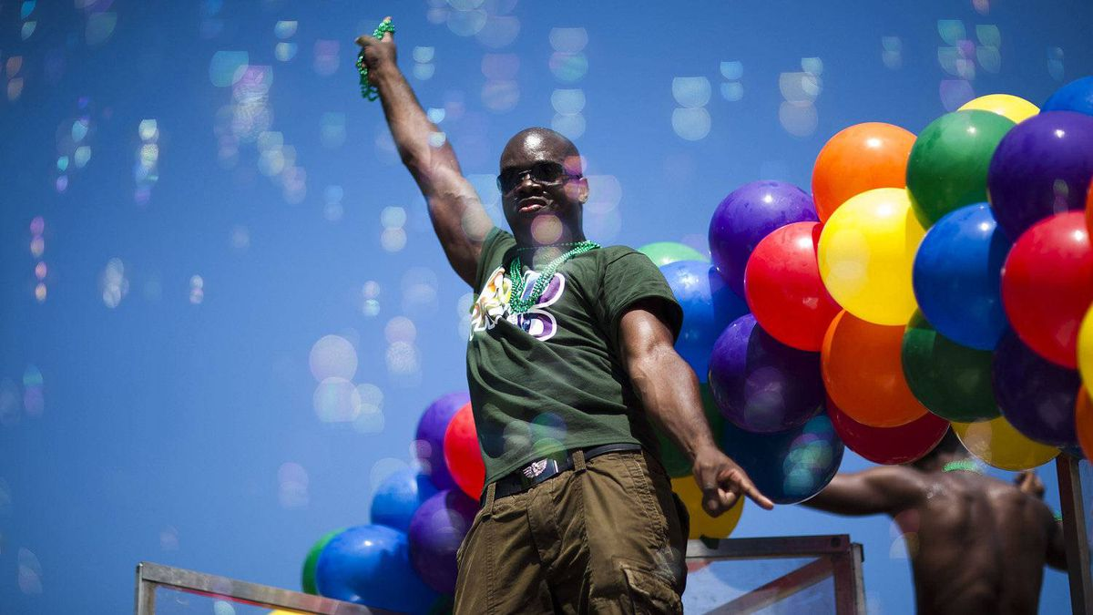 People dance on a float as it passes by during the annual Vancouver Pride Parade in downtown Vancouver, British Columbia, Sunday, July 31, 2011.