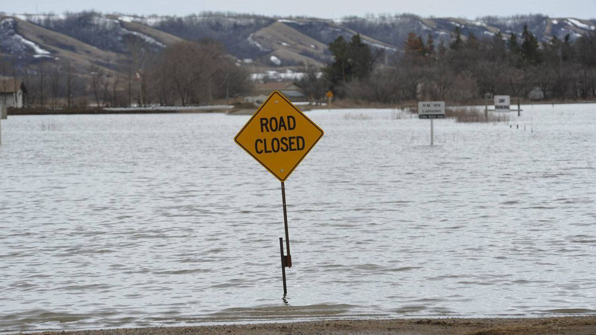 A road is closed due to high water in the Qu'Appelle Valley northwest of Regina.