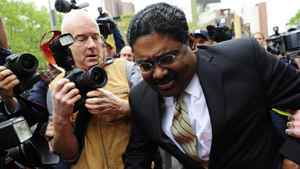 Former hedge fund founder Raj Rajaratnam leaves court after he was convicted on all counts of fraud and conspiracy in Wall Street's biggest insider trading trial for years, in New York, on May 11, 2011.