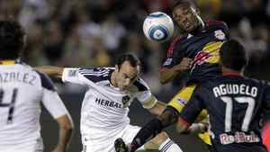 Los Angeles Galaxy forward Landon Donovan, centre, and New York Red Bulls midfielder Dane Richards head the ball during the second game of an MLS soccer Western Conference semifinal at Home Depot Center in Carson, Calif., on Nov. 3, 2011.