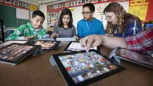 Royan Lee, a teacher at Beverley Acres Public School uses technology to create a more interactive, collaborative and social classroom. Here students learn how to use GarageBand for iPads on November 18, 2011.
