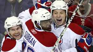 Montreal Canadiens center Ryan White (53) celebrates his first goal of the season against the Minnesota Wild with defenseman P.K. Subban (76) and center David Desharnais (58) during the first period of their NHL hockey game in St. Paul, Minnesota, March 20, 2011. REUTERS/Eric Miller