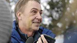 Sporting a bruised face and bloodshot eye, Buddy Tavares speaks to media at a protest in Kelowna, Jan. 16 2011.