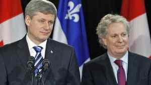 Prime Minister Stephen Harper and Quebec Premier Jean Charest hold a news conference in Riviere-du-Loup on Jan. 12, 2010.