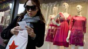 A shopper checks her receipt outside Macy's in New York in this file photo.