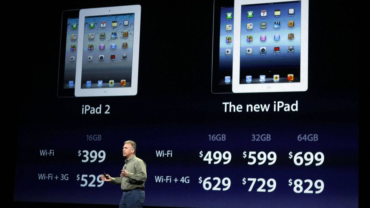 Apple's senior vice-president of Worldwide Marketing Phil Schiller speaks on stage, while pricing for the new iPad is projected on the screen, during an Apple event in San Francisco, March 7, 2012.