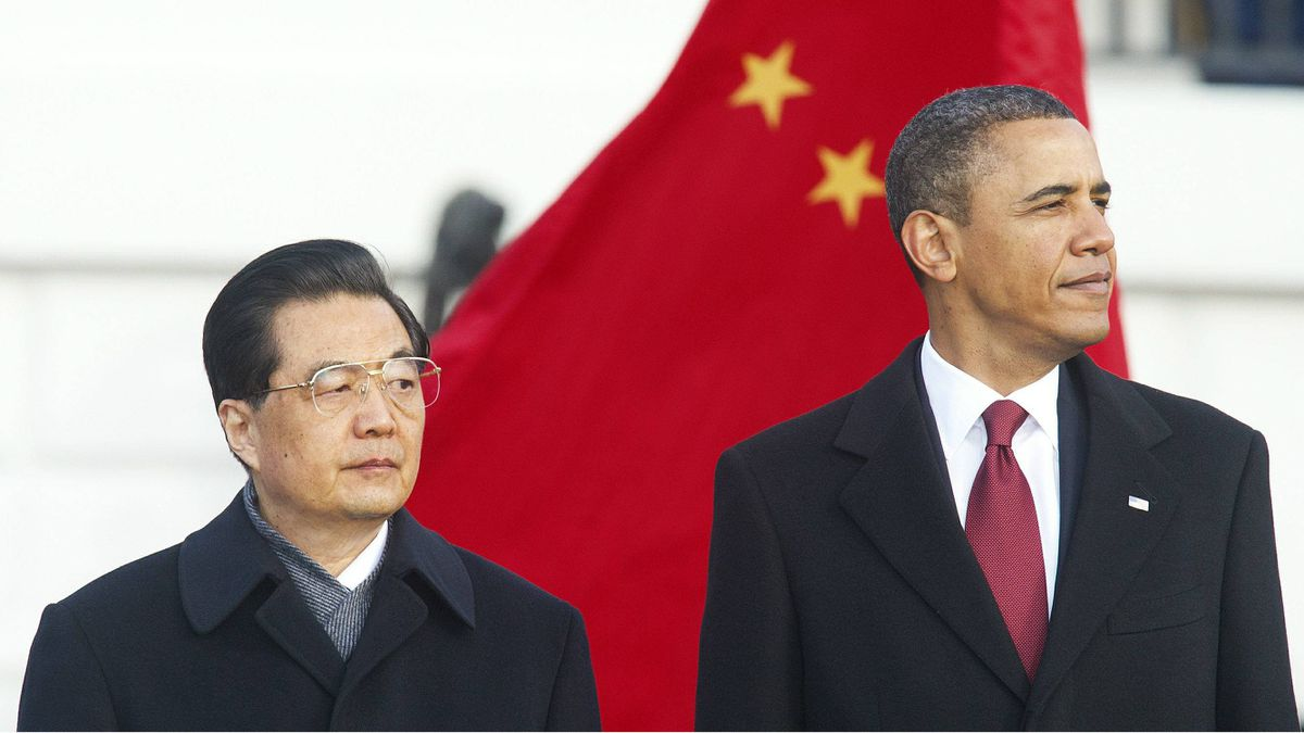 """US President Barack Obama stands with Chinese President Hu Jintao(L) during a State Arrival ceremony on the South Lawn of the White House in Washington, DC, January 19, 2011. Hu said Wednesday he could see """"new progress"""" in his country's ties to the United States as he was welcomed to the White House by US leader Barack Obama."""
