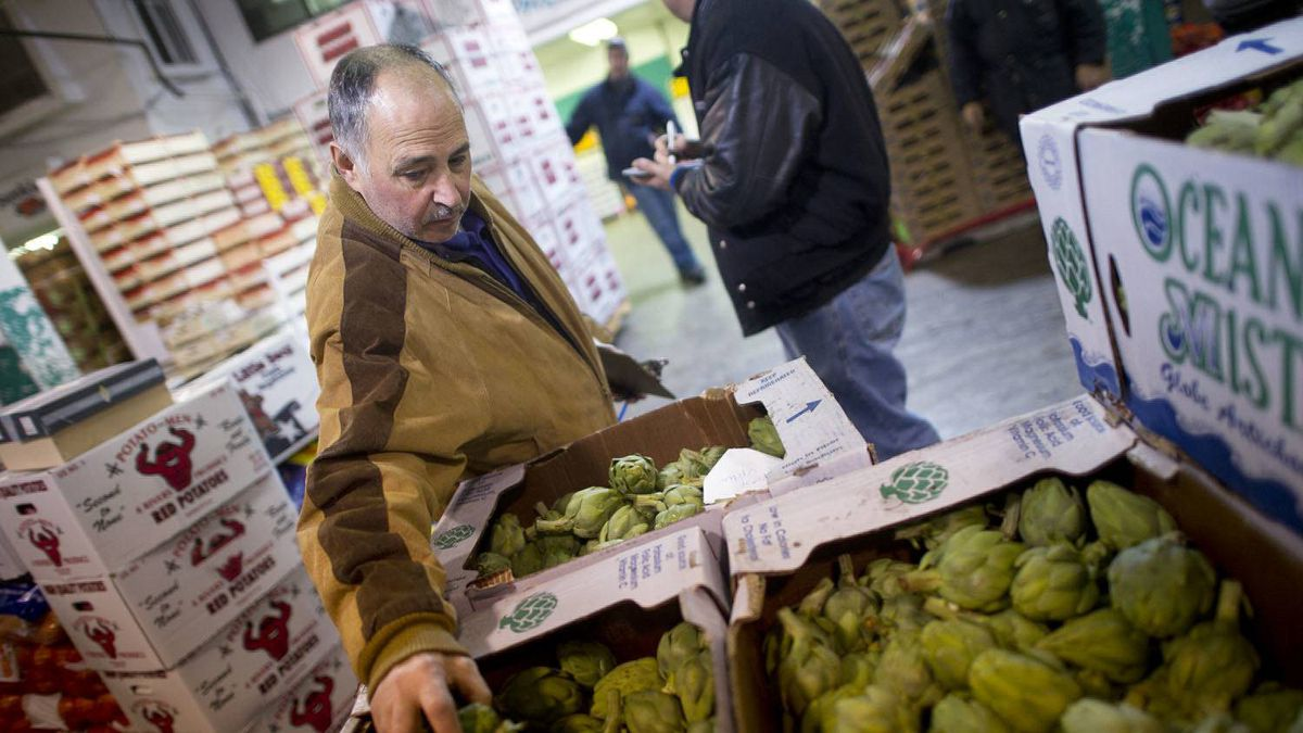 Buyers that supply supermarkets and local chefs pick up their produce at the Ontario Food Terminal in Toronto, Ont. Nov. 18, 2010.