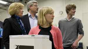 Laureen Harper, Prime Minister Stephen Harper and their children Rachel and Ben look to staff as Mrs. Harper realizes that she left her Identification in the car as they cast their ballots in Calgary, Alta., Monday May 2, 2011.