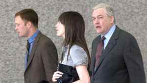 Conrad Black (R) enters the Dirksen Federal Court Building for his fraud and racketeering trial with his daughter Alana Black (M), son Jonathan Black (L) in Chicago, Illinois May 15, 2007.