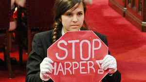 Page Brigette DePape stages a protest in the middle of the Senate floor during the Speech from the Throne on June 3, 2011.