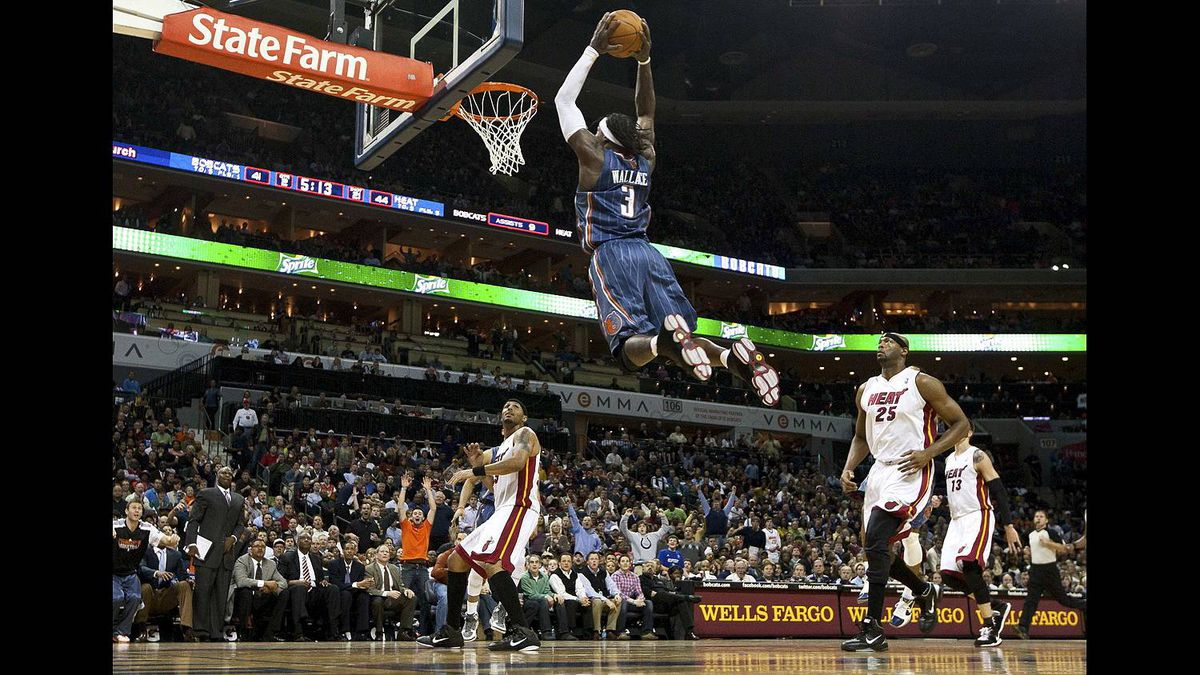 Charlotte Bobcats small forward Gerald Wallace goes in for a dunk against Miami Heat during their NBA basketball game in Charlotte Feb. 4