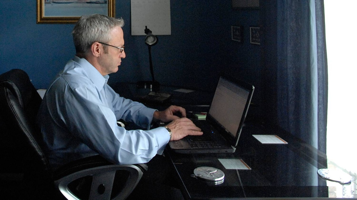 Michael Kennedy is Canadian sales manager for Basic Research Inc, a U.S. based cosmetics company. He is seen here in his home office in Cambridge, Ontario.