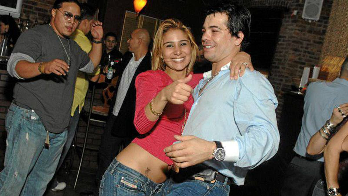 In an undated photo, Gatti is seen with his wife, Amanda Rodrigues, during happier times.