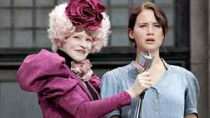 "The coal miner's daughter (Jennifer Lawrence as Katniss Everdeen) and the evil rich person (Elizabeth Banks as Effie Trinket) in a scene from ""The Hunger Games"""