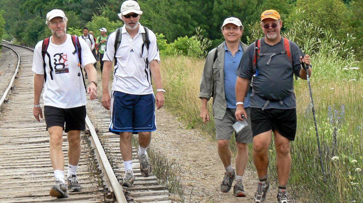 Frank Archibald, left, Dave Morritt, Randy Pepper and Tim Belanger take part in the 100-kilometre Trailwlker hike to raise money for Oxfam Canada.