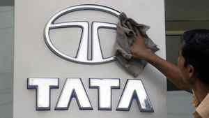 A worker cleans a Tata Motors logo outside its showroom in the southern Indian city of Hyderabad October 26, 2009.