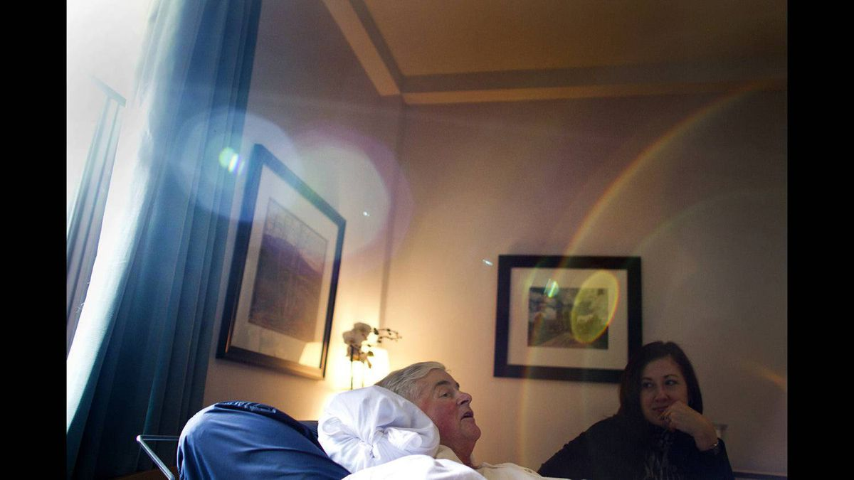 Marianne Kupina shares a moment with her husband, Andrew McCarthy, at the Kensington Hospice in Toronto on Feb. 7, 2012. He died at the hospice on Feb. 20, 2012.