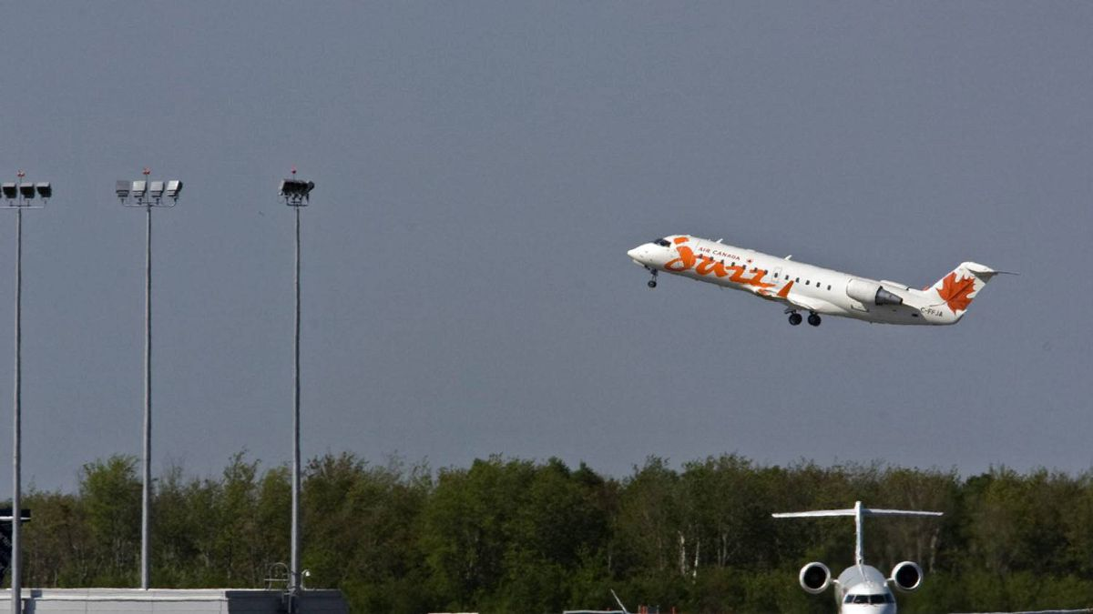 An Air Canada Jazz jet takes off at the airport in Halifax on Monday, May 24, 2010.