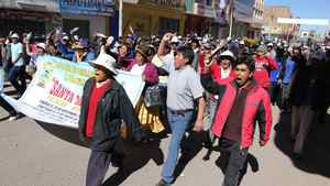 """Demonstrators march against violence in Juliaca, southern Peru, on June 25, 2010. Canada's Bear Creek Mining Corp. said it will use """"all available avenues"""" to insist on its right to open a silver mine in the mountains of southeastern Peru, after authorities suspended its concession."""