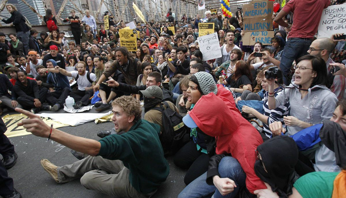 Protesters react as police officers start to make arrests on the Brooklyn Bridge during an Occupy Wall Street protest in New York October 1, 2011.