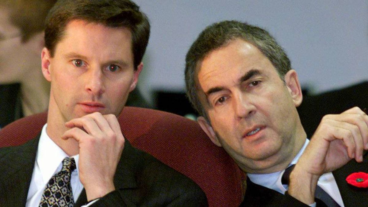 Onex Corp president Gerald Schwartz chats with managing director Nigel Wright prior to an appearance before a Senate committee in Ottawa on Nov 2, 1999.