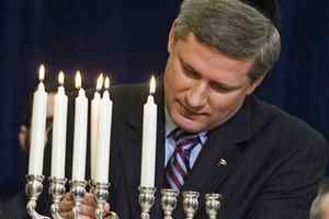 Prime Minister Stephen Harper takes part in a menorah lighting ceremony on Parliament Hill on December 19, 2006.
