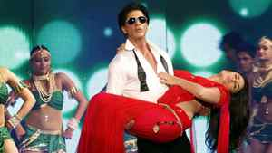 Shah Rukh Khan (standing) and Kareena Kapoor take part in a launch ceremony for RA.One.