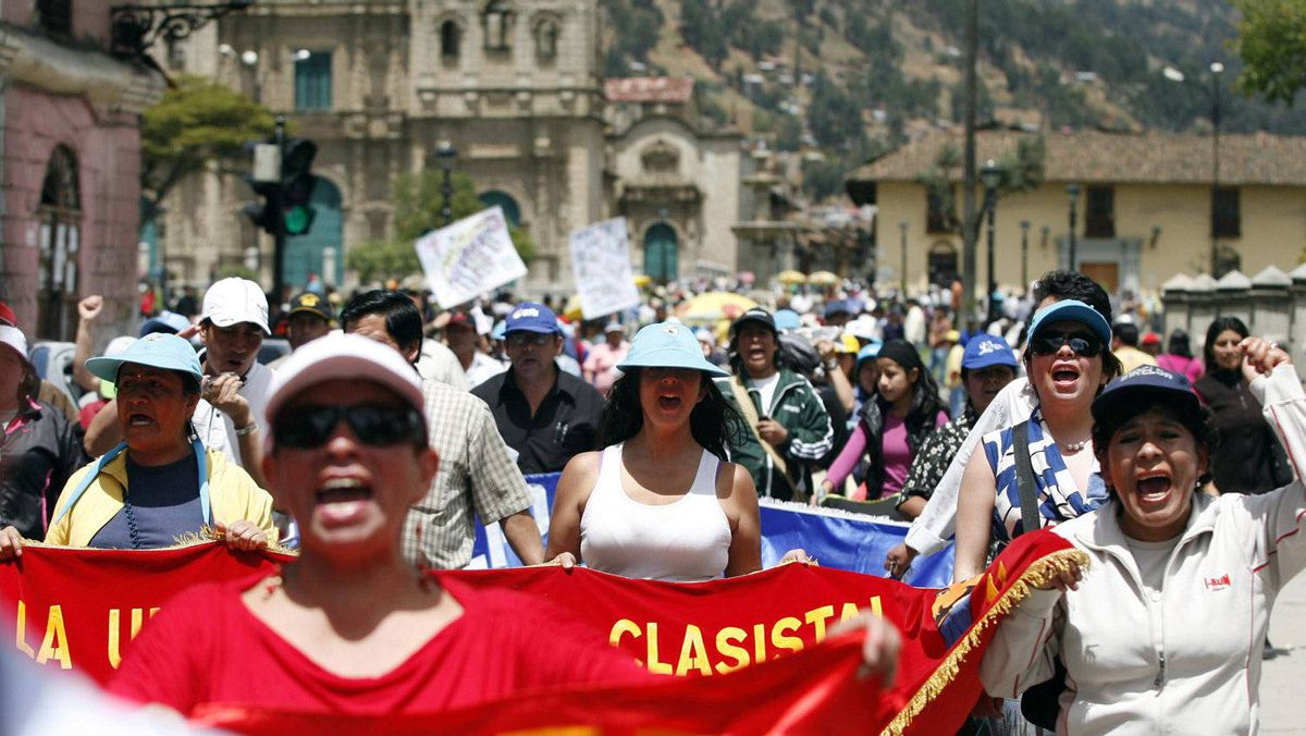 Protesters march during the second day of strike against Newmont's proposed $4.8-billion Conga gold mine, at the Peruvian city of Cajamarca.