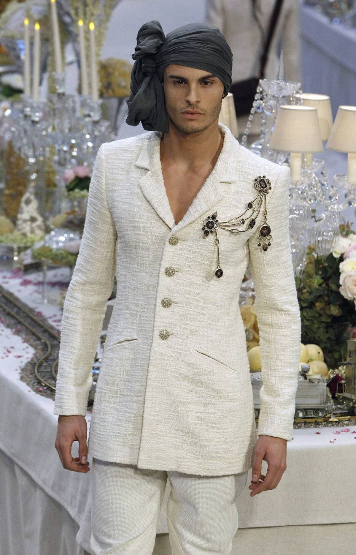 Lagerfeld didn't leave out the men entirely. All of the looks featured wrapped headdresses that weren't quite turbans but might just find a following among the unlikeliest types. Lil' Wayne, perhaps? And doesn't every man need a four-button white bouclé jacket?