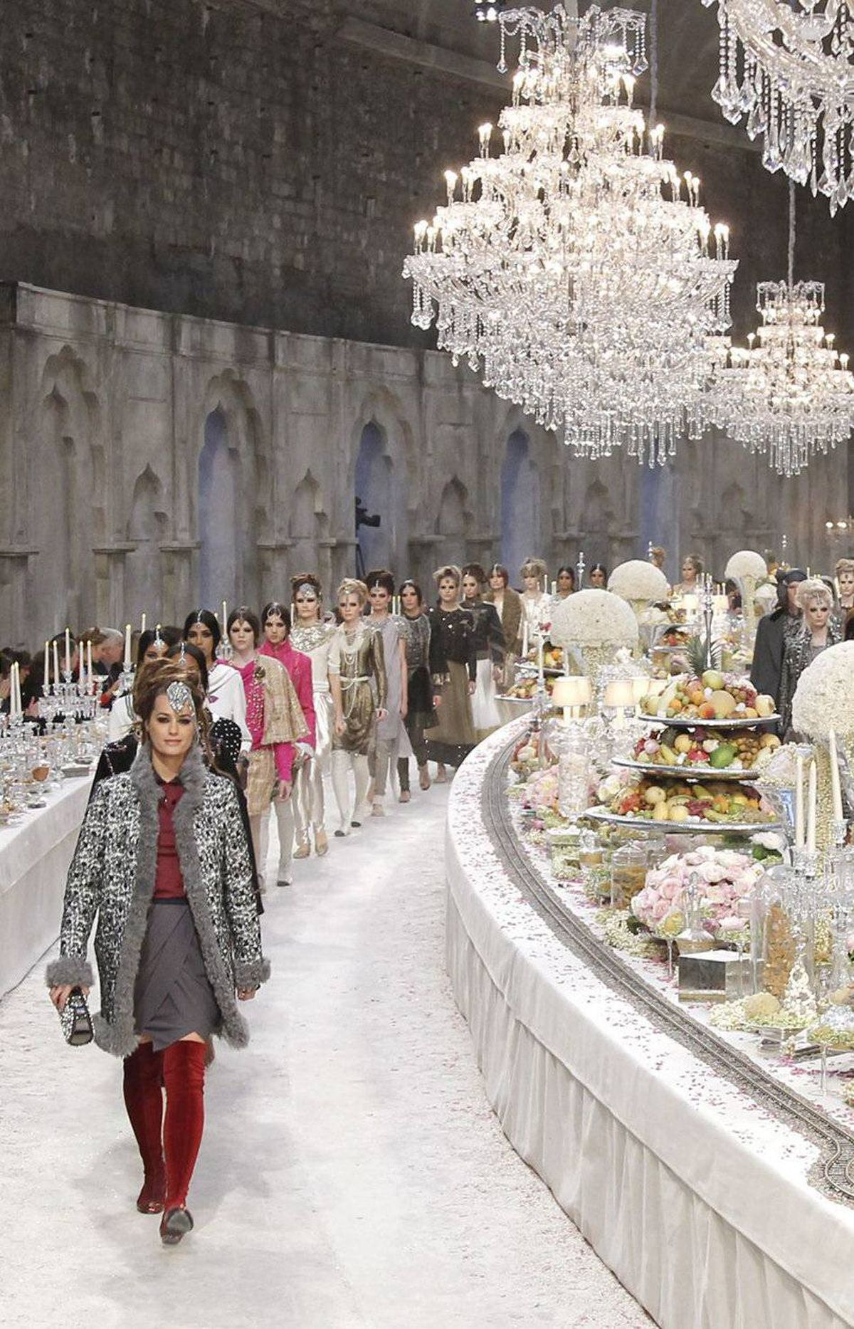 An upper hall of the Grand Palais in Paris was transformed into a dreamy banquet. Think traditional high tea with equal parts Bombay and Paris. Every single detail, from huge (the backdrop of aged, decorative arches) to tiny (gold foil dusted onto the fruit) is proof Chanel never goes halfway.