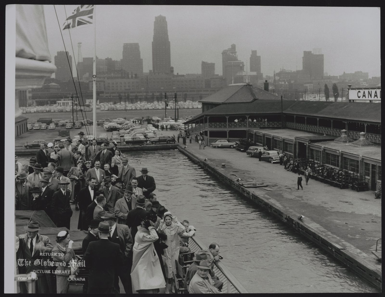 SS CAYUGA (SHIP) TORONTO'S SKYLINE IS SEEN FROM THE DECKS OF THE CAYUGA -- Toronto's skyline is seen from the decks as passengers climbed aboard. Crowd of about 300 made voyage around Toronto Island. It was the Cayuga's first trip in nearly three years, June 3, 1954