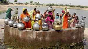 Women gather at a village well to draw drinking water at Kayla village, 65 km west of the Indian city of Ahmedabad, May 5, 2009.