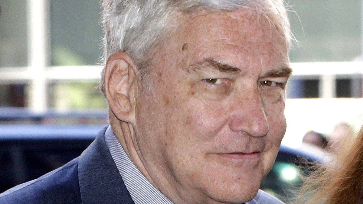 Former media mogul Conrad Black, right, arrives at the federal courthouse with his wife Barbara Amiel Friday, July 23, 2010 in Chicago.