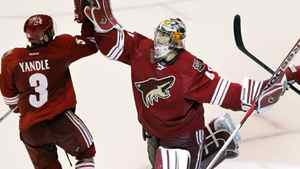 Phoenix Coyotes goalie Mike Smith, right, celebrates their 5-3 win over the Nashville Predators with Keith Yandle after Game 2, Sunday, April 29, 2012, in Glendale, Ariz. The Coyotes won 5-3.