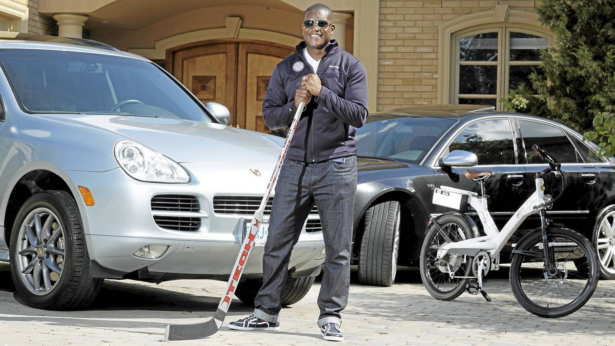 Former NHL goaltender and now Hockey Night in Canada broadcaster, Kevin Weekes photographed on Sept. 20, 2011 for Globe Auto feature. He drives a Porsche Cayenne and a Audi S8. He also has two A2B electronic bikes. (Photo by Peter Power/The Globe and Mail)