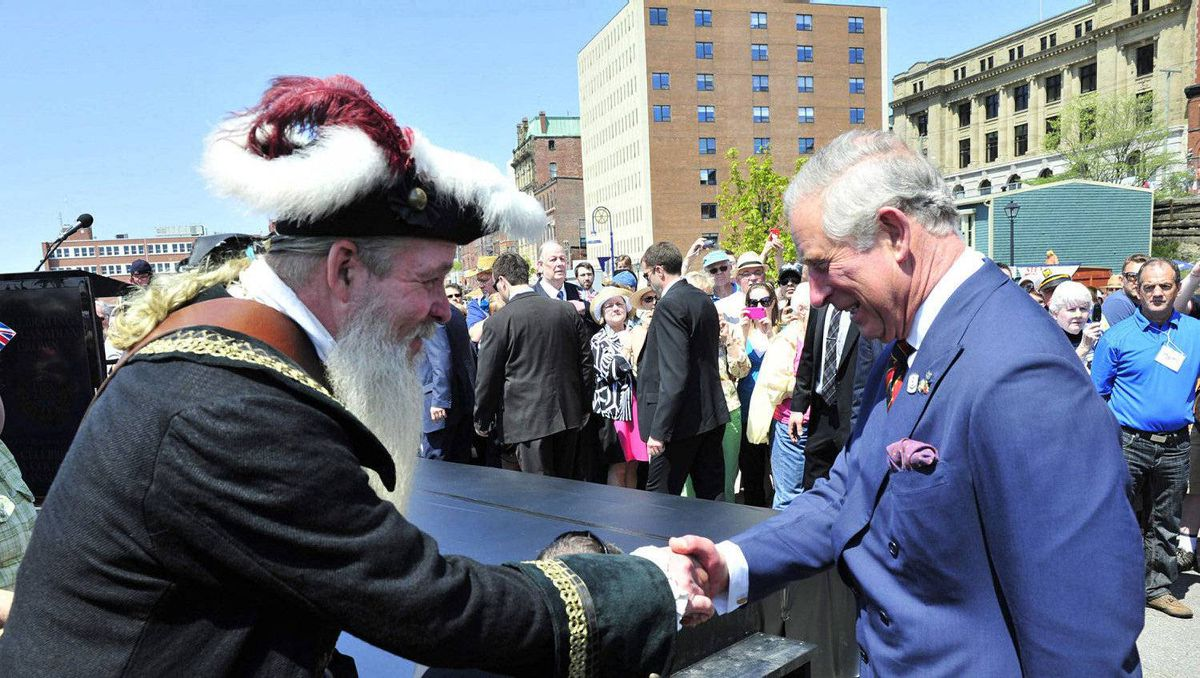 Prince Charles is greeted by a supporter during a walk about Saint John, N.B., on Monday, May 21, 2012. The royal couple are visiting to Canada to mark the Queen's Diamond Jubilee.