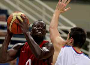 Denham Brown of Canada, left, jumps to score as Ivan Paunic of Serbia defends during the Acropolis basketball tournament at the indoor Olympic stadium of Athens, Wednesday, Aug. 18, 2010.(AP Photo/Thanassis Stavrakis)