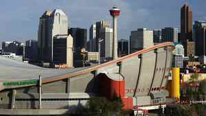 The downtown skyline of Calgary with the Pengrowth Saddledome in the foreground. photo by Larry MacDougal