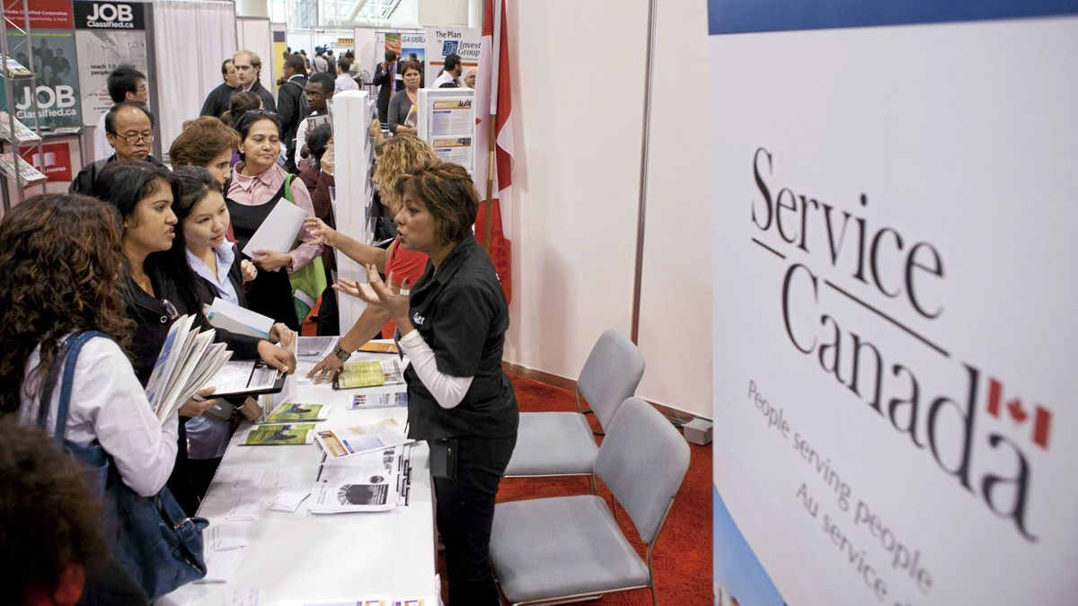Job seekers speak with personnel at the Service Canada kiosk during the 19th edition of the National Job Fair and Training Expo at the Metro Toronto Convention Centre on Tuesday, September 27, 2011