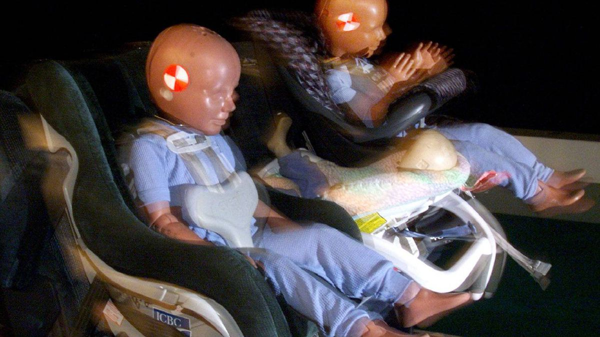 Crash dummies are restrained during the simulation of a 15-km an hour crash test by the Insurance Corporation of B. C. Friday Aug. 27,1999.