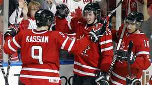 Canada's Ryan Johansen (C) celebrates his goal on the USA with teammates Zack Kassian (L) and Brayden Schenn during the second period of their semi-final game at the IIHF World Junior Hockey Championships in Buffalo, New York January 3, 2011.