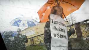 Teachers walk an information picket line at Sir Guy Carleton school in Vancouver March 5, 2012.