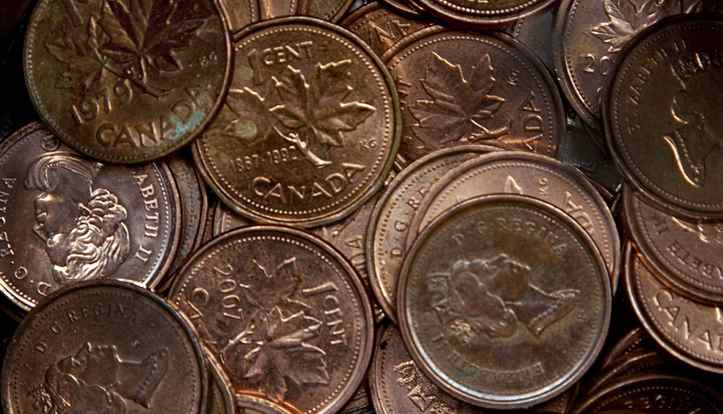 A handful of one cent coins is seen in Dartmouth, N.S, March 29, 2011. THE CANADIAN PRESS/Andrew Vaughan