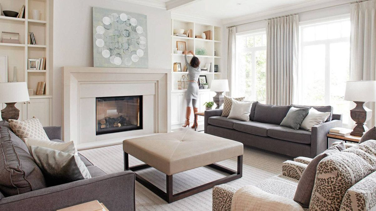 An airy room needs to be grounded by a weighty architectural element, hence the concrete fireplace.