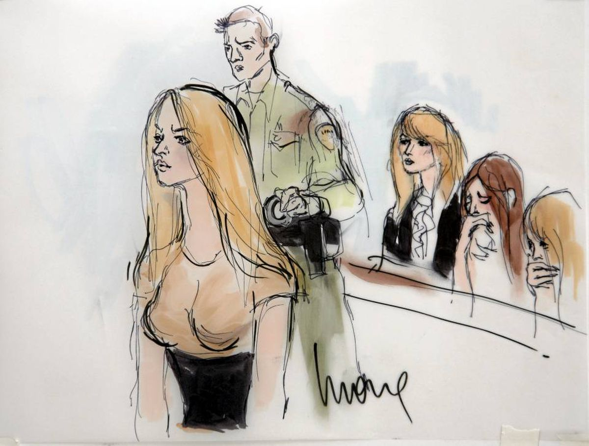 In a courtroom sketch drawn by Mona Shafer Edwards, actress Lindsay Lohan is taken into custody at court in Beverly Hills, Calif.