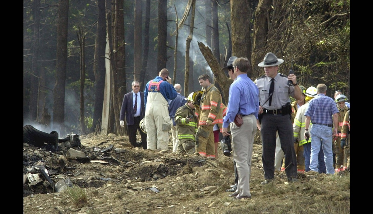 Firefighters and emergency personel investigate the scene of a fatal crash involving a United Airlines Boeing 757 with at least 45 passengers Tuesday morning, Sept. 11, 2001 near Shanksville, Pa., Somerset County.