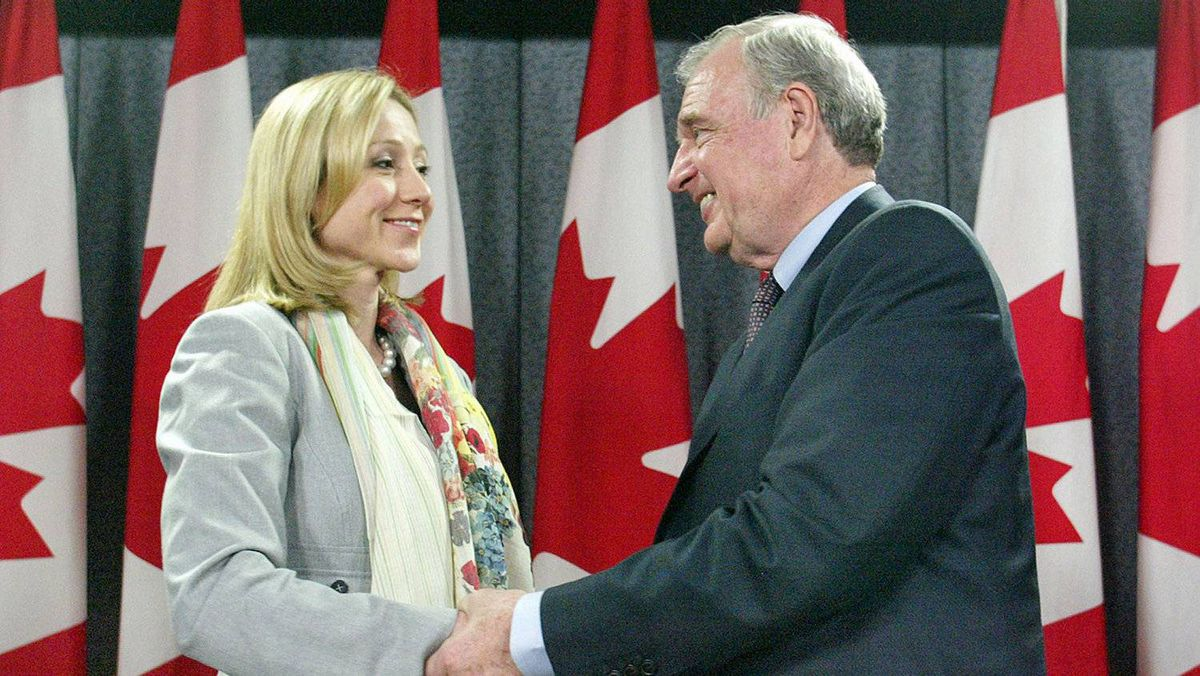Prime Minister Paul Martin welcomes Tory defector Belinda Stronach to the Liberal at a news conference in Ottawa on May 17, 2005.